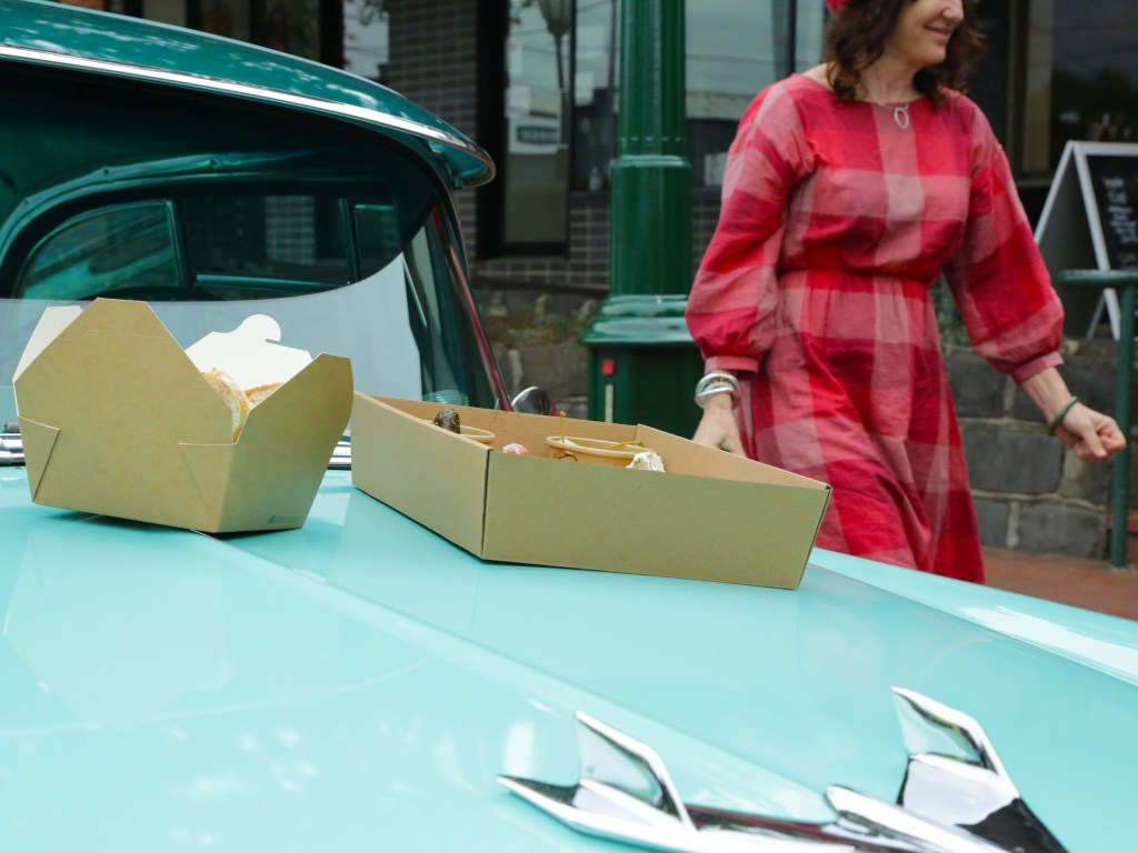Bonnet picnic in front of Kitchen & Butcher, Healesville.
