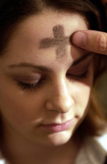 YOUNG WOMAN RECEIVES MARK OF ASHES