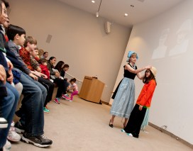 Newman interacts with an audience member during her April Late Night performance inspired by the art of Cindy Sherman