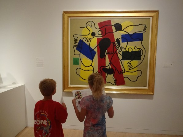 Two junior detectives inspect The Divers by Fernand Leger for clues.