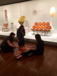 McDermott Interns exploring activities with the Marshmallow sofa (George Nelson Associates, Herman Miller, Inc. and Irving Harper, Dallas Museum of Art, 20th Century Design Fund, 1995.41)