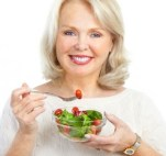 50+ woman eating a salad