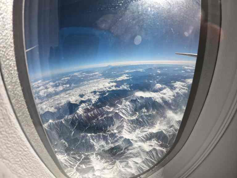 View of Japan Alps through the window of the plane