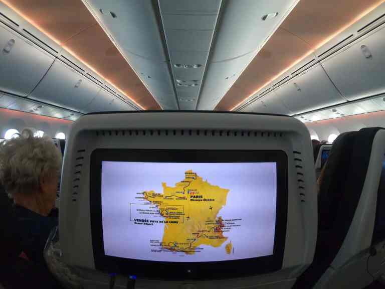 photo of Tour de France map on TV screen in plane