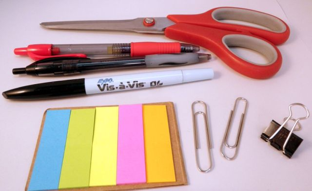 Scissors, pens, clips, and post-it flags