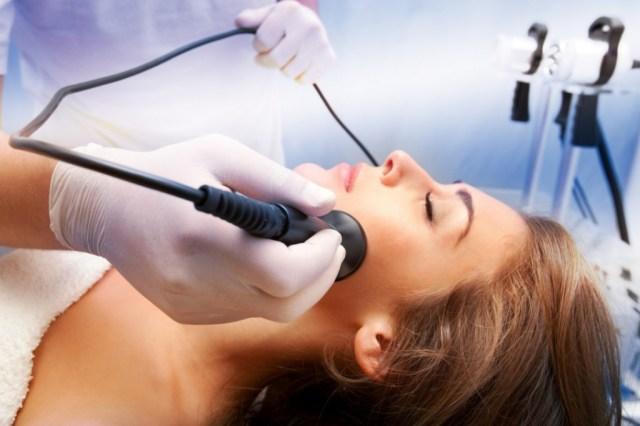 doctor performing a laser peel