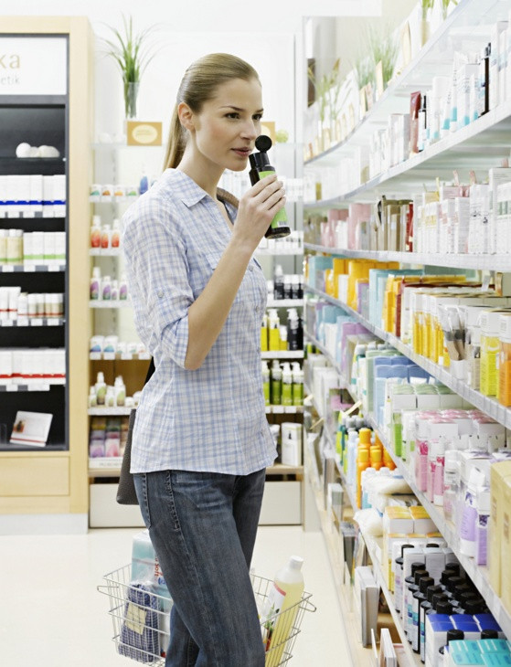 woman examining skin care product