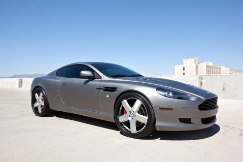 Scottsdale, Arizona, USA - June 13, 2011: A photo of a parked Aston Martin DB 9 sports car with custom wheels. Every Aston Martin is hand built in England.