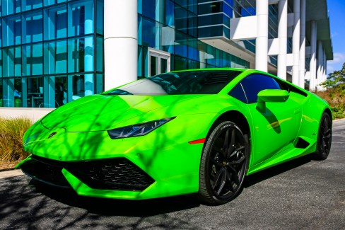 Sarasota, FL, USA - February 20, 2016: Bright green 2015 Lamborghini Huracan sports car in a parking lot in Sarasota Florida