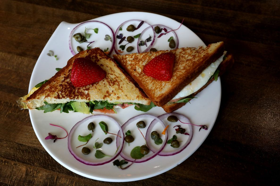 The Pink Lady Sandwich - Texas Brioche toast with smoked salmon, two fried eggs, arugula, avocado and jalapeno mayo - is a popular item at Nest Cafe in Frisco.