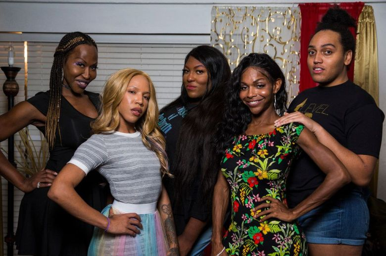"""From left, LeShay Weeks, Alana Bursey, Robyn """"Pocahontas"""" Crowe, Mieko Hicks, and Marquel Dominique at Weeks' home in Dallas. The group hosts a weekly radio show called Trans-Fusion, where they talk about their experiences as black transgender women."""