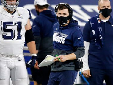 The Dallas Cowboys offensive coordinator Kellen Moore is pictured on the sidelines during the fourth quarter against the Washington Football team at the AT&T Stadium in Arlington on Thursday, November 26, 2020.