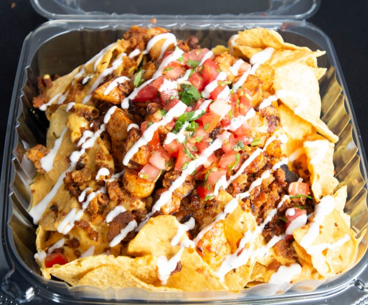 Shrimp nachos at Brandon Waller's food stand in Dallas Farmers Market on June 2, 2019 in Dallas, Texas. (Robert W. Hart/Special Contributor)