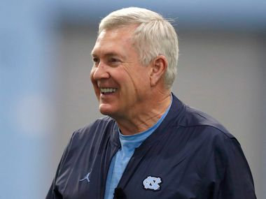 FILE - In this March 3, 2019 file photo, North Carolina coach Mack Brown smiles during the NCAA college football team's first practice of the season in Chapel Hill, N.C. Brown is back for a second stint at North Carolina after more than two decades away. He led the Tar Heels to consecutive top-10 finishes in 1996 and '97 before moving to Texas, then spending the past few years in broadcasting.