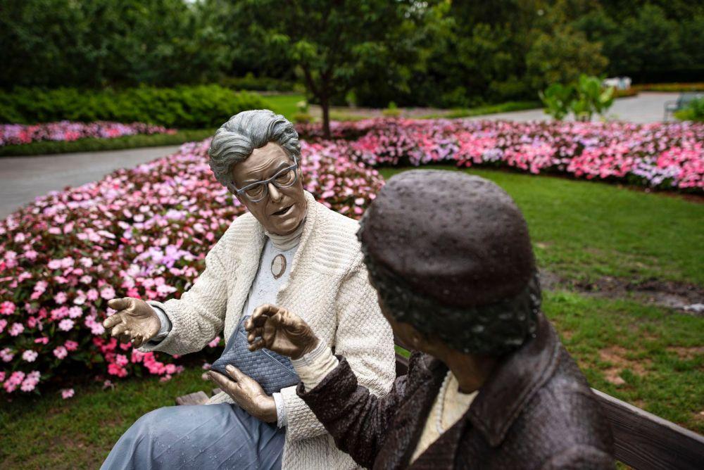 "The sculpture Crossing Paths is part of Seward Johnson's ""Celebrating the Familiar"" exhibit at the Dallas Arboretum."