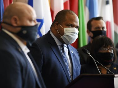 Dallas Mayor Eric Johnson, center, was flanked by members of Dallas City Council at a news conference addressing protests after Geroge Floyd's death. Police funding and the mayor's opposition to cutting police overtime became a central campaign issue during this year's elections.
