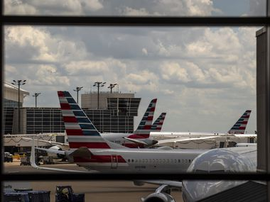 Planes from American Airlines outside Terminal B at DFW International Airport.