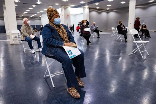 Gladys Rodgers, 77, waits after receiving the COVID-19 vaccine on Thursday, January 14, 2021 in the field of post vaccination at Fair Park in Dallas.  A limited number of COVID-19 vaccine shots will be available in Fair Park on Thursday.  North Texas 75 and older.  (Juan Figuera / The Dallas Morning News)