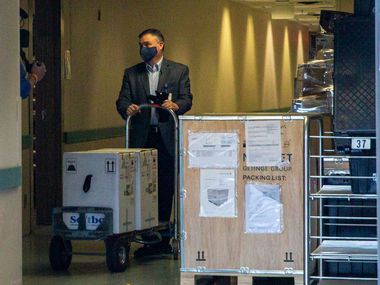 Vice President and Chief Pharmacy Officer Jon Albrecht receives a shipment of the Pfizer COVID-19 vaccine at Methodist Dallas Medical Center on Monday.