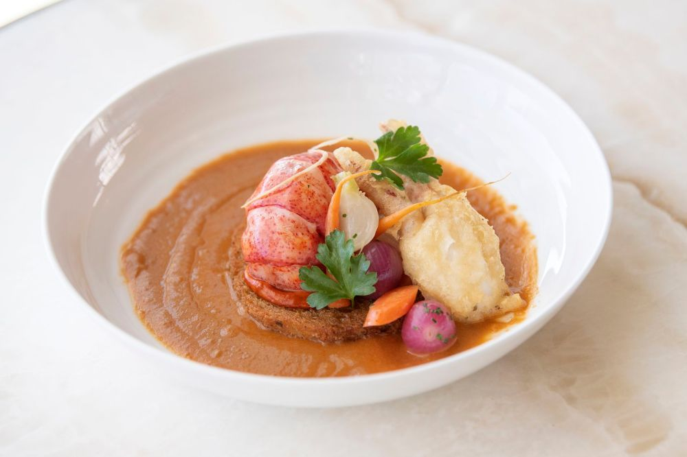 Bisque de Homard is served at Bullion, Feb. 6, 2020, in downtown Dallas. The dish includes a Lobster bisque, brioche croutons, lobster tempura and a saffron aioli. (Jeffrey McWhorter/Special Contributor)