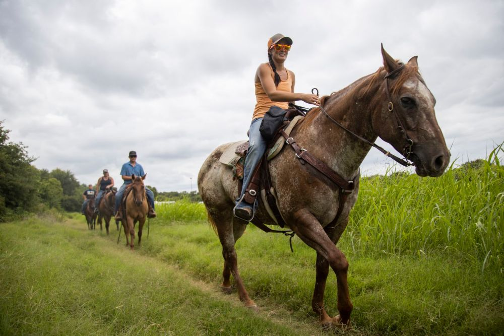 Riders celebrate a friend's birthday by having a ride through the equestrian trail at Ray Roberts Lake State Park on July 25, 2020.