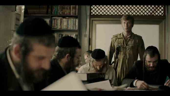 Menny's son Yoni inside the public library in the post credit sequence
