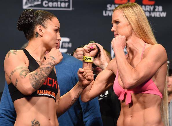 LOS ANGELES, CA - FEBRUARY 27: (L-R) Opponents Raquel Pennington and Holly Holm face off during the UFC 184 weigh-in at the Event Deck and LA Live on February 27, 2015 in Los Angeles, California. (Photo by Josh Hedges/Zuffa LLC/Zuffa LLC via Getty Images