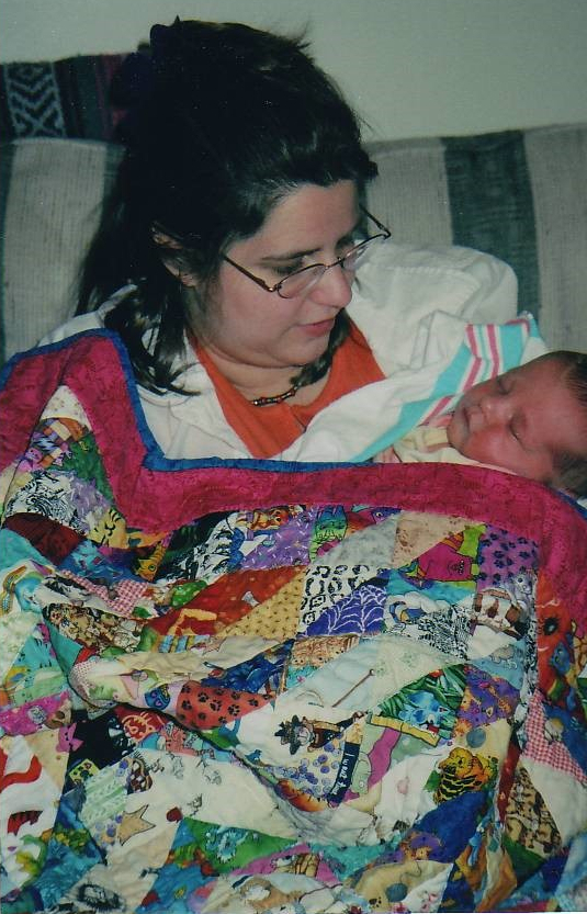 quilt-with-baby-1849777841-1576724008267.jpg