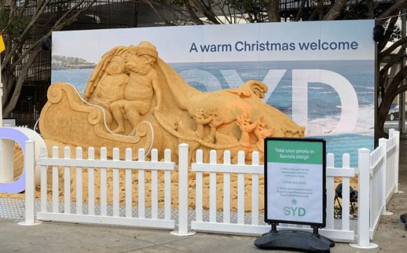 Australia sand carving Santa.png