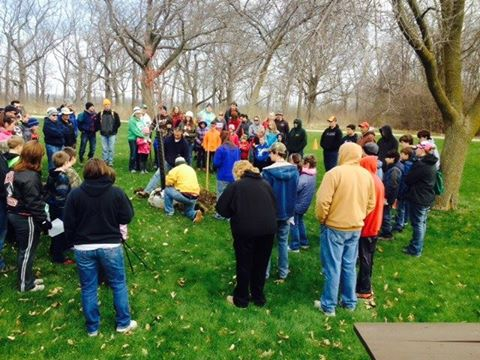 Volunteers participate in an Arbor Day Tree Planting at High Cliff State Park.