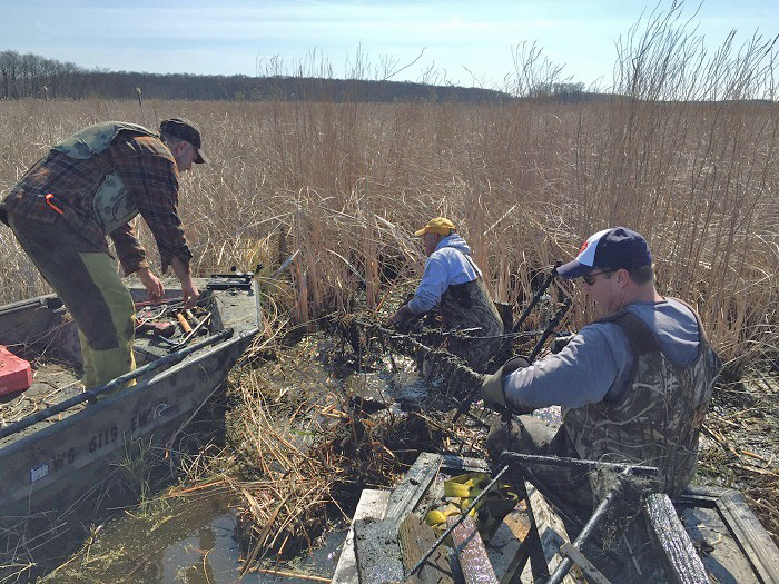 Ron Churchill, Tom Pagel and Don Guenther from the Waukesha County and Twin Rivers chapters of the Wisconsin Waterfowl Association work with DNR staff to manage wetlands within Rome Pond Wildlife Area.