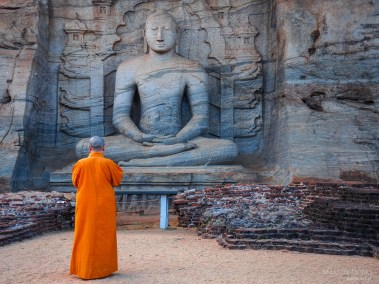 Unique monolith Buddha statue in Polonnaruwa temple and monk  -