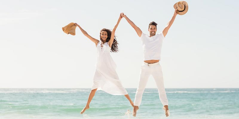 Couple jumping from happiness