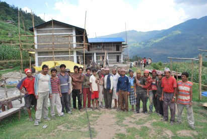 A proud workforce infront of a nearly completed school at Tikedunga, 2010