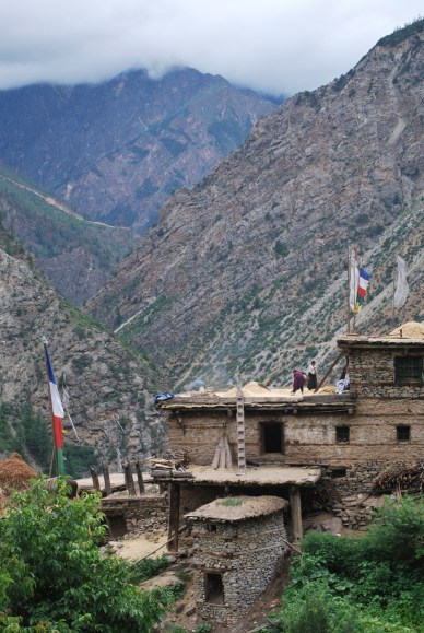 This is a traditional design of houses in Humla. It allows for the steepness of the terrain and maximises space by using other peoples roofs for working or storage.