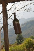 An old mountaineering oxygen bottle found on the old route to Everest Base Camp, now used as a school bell in Nepal Danda school, along the Arun Khola.