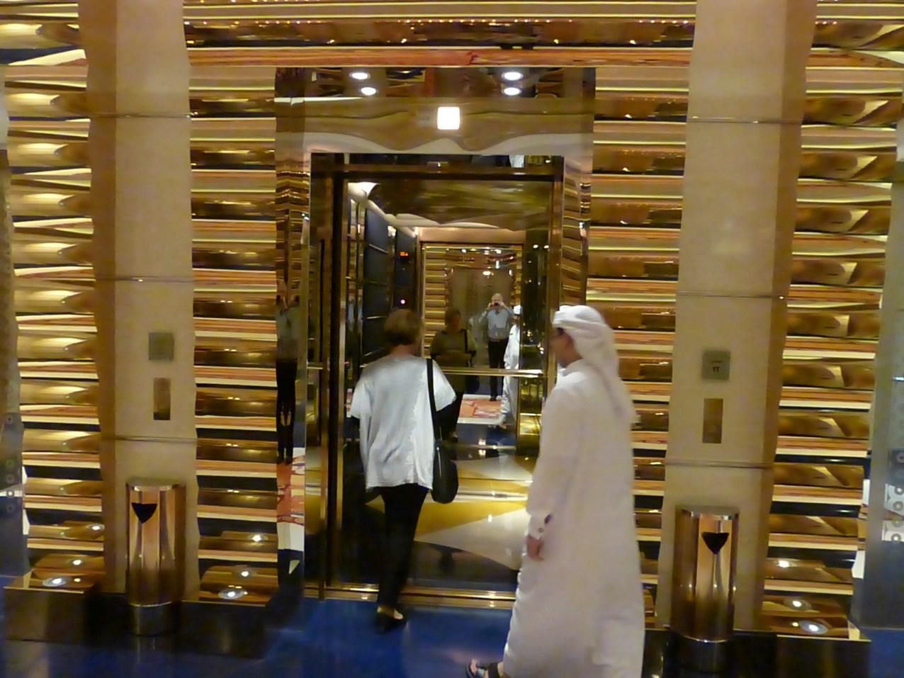 Deb going into elevator up to top floor