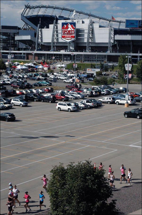 Runners outside Mile High Stadium