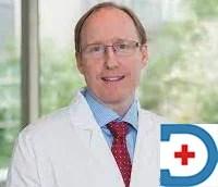 Dr Christopher E Comstock