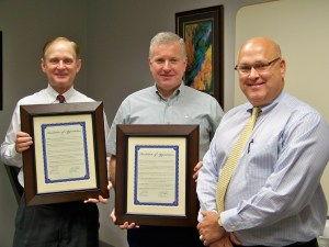 Terry Morgan and David Perkins receive Resolutions of Appreciation from Les Leach, Administrator for CHI St. Luke's Memorial Specialty Hospital for their service. Morgan has served on the Board for 9 years and Perkins has served 15 years.