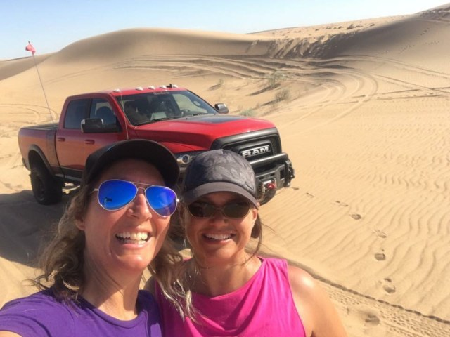 Nena Barlow (left) out teaching driver Tory Capezza how to drive in the dunes with the Ram Power Wagon.