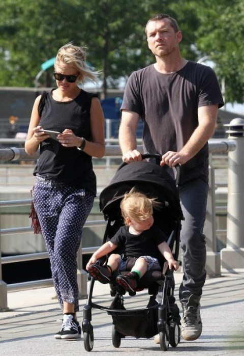 Wife and Husband, Lara and Sam with their baby son.