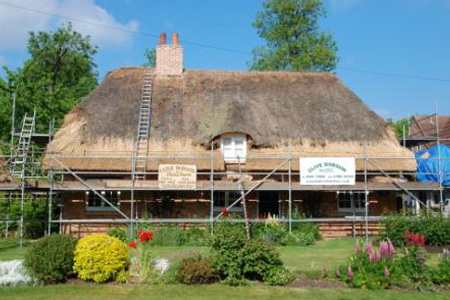 Combed Wheat Reed Thatch On A Cottage Being Stripped