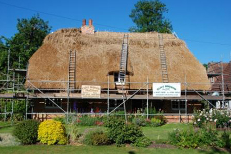 Combed Wheat Reed Cottage Part Way Through Replacement