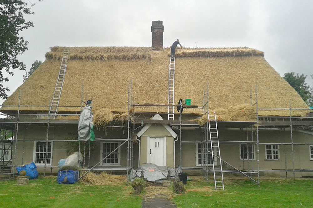 Vintage Cottage With Longstraw Replacement Thatch Almost Complete Having Block Cut Ridge Added