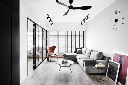 Sala de estar com decoração minimalista e industrial