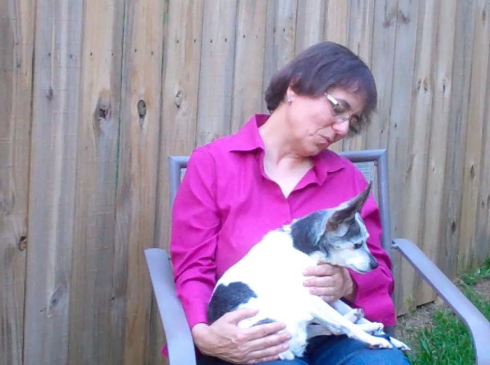 Eileen Anderson holding rat terrier Cricket with advanced dementia