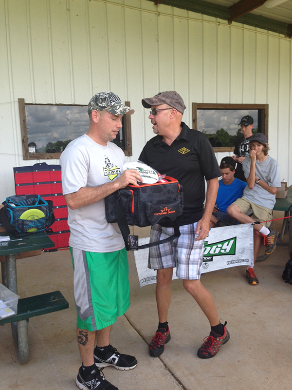 Jason Kirkaldy (left), Saturday's first round Winner accepting his prize pack from TD Walter Black (right).