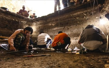 In this 2012 photo provided by the Liang Bua Team archaeological excavations of Holocene deposits at Liang Bua are conducted on the Indonesian island of Flores These sediments contain skeletal and behavioral evidence of modern humans Homo sapiens Liang Bua Team via AP MANDATORY CREDIT