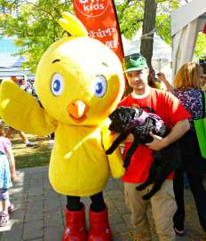 Victor poses with Chirp the Owl Magazine mascot and helping hand
